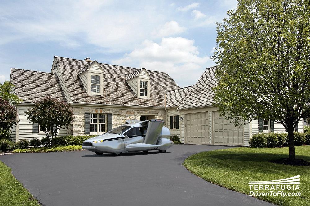 Voiture volante TF-X garée devant une maison